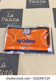 SANTIAGO, CHILE - 1 Jun 2015: Getting ready to spice things up with a packet of Aji Chileno at the Santiago airport.