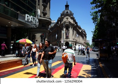 Santiago, Chile - 27 November, 2018: Street life in front of Santiago Stock Exchange building or Bolsa de Comercio in financial district