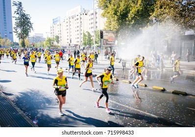 Santiago, Chile. April 07, 2013. Santiago City Marathon, firefighters refreshing runners.