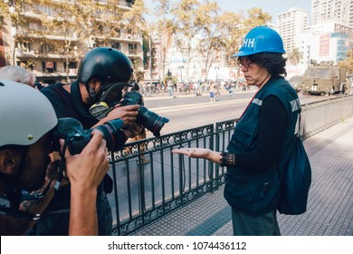"Santiago, Chile - April 19, 2018: Representative of ""Human Rights"" shows photojournalists a bullet found in the road during the march against the profit in education in Santiago de Chile"