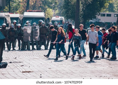 Santiago, Chile - April 19, 2018: Chilean riot Police disperse protesters during a demonstration demanding an end to the Profit in the Education.