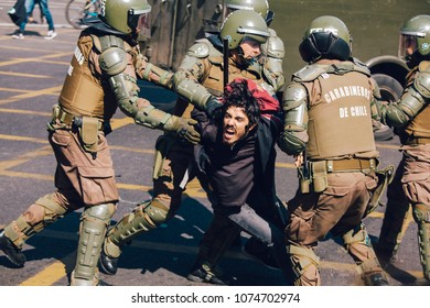 Santiago, Chile - April 19, 2018: Protester arrested by the chilean riot police during a demonstration demanding an end to the Profit in the Education.