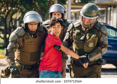 Santiago, Chile - April 19, 2018: Protester arrested in the University of Santiago during a demonstration demanding an end to the Profit in the Education.