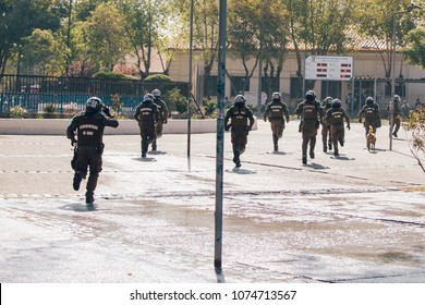 Santiago, Chile - April 19, 2018: Riot police enter the University of Santiago looking for protesters during a demonstration demanding an end to the Profit in the Education.