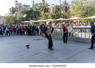 Santiago, Chile- April 21, 2019: Street musicians perform at Santiago's Plaza de Armas.