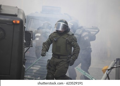 Santiago, Chile - August 09, 2011: Chilean riot police amid tear gas clears barricades during a student strike in Santiago's Downtown, Chile.