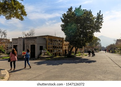Santiago, Chile - August 17, 2019: Family visits deceased relatives in the General Cemetery of Santiago, Chile.