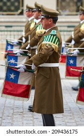 SANTIAGO, CHILE - AUGUST 4, 2014: Members of the Carabineros Band at the changing of the guard ceremony at La Moneda in Santiago, Chile