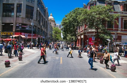 Santiago, Chile - Dec 28, 2018: People walk at Plaza de las Armas square in Santiago, Chile.