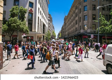Santiago, Chile - Dec 28, 2018: People cross the pedestrian crossing in centre of Santiego , Chile.
