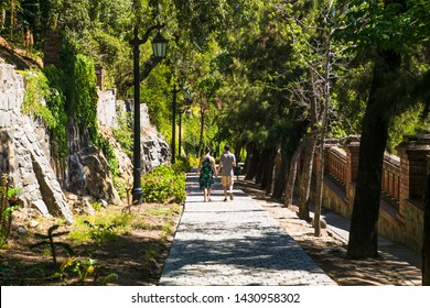 Santiago, Chile - Dec 28, 2018: A young couple walking through the park at Santa Lucia hill in Santiago ,  Chile city.
