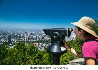 Santiago, Chile - Dec 29, 2018: Beautiful woman with hat looking funicular to Cerro San Cristobal hill in Santiago, Chile