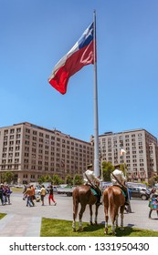 Santiago, Chile, December 17, 2017:  Two guards mounted police outside the Moneda Palace, Presidential Palace in  Santiago, the capital of Chile.