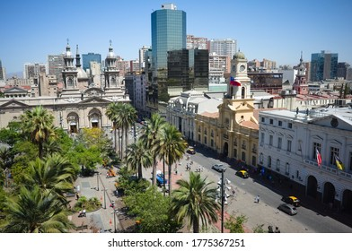 Santiago, Chile - February, 2020:View of Plaza de Armas main city square of Santiago de Chile at sunny day from rooftop. Santiago Metropolitan Cathedral and National Historic Museum. City skyline view