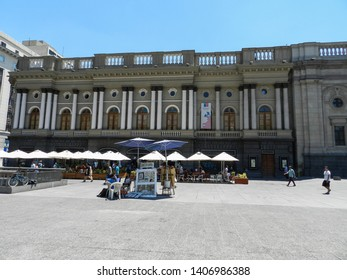 SANTIAGO, CHILE - JANUARY 11, 2015: Plaza de Armas, considered the heart of the capital of Chile, marking the landmark known as kilometer zero of the country.  There are sculptures and activities.