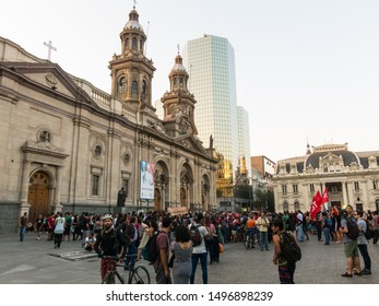 SANTIAGO, CHILE - JANUARY 22, 2018: Demonstration for the Mapuche rights, front the Metropolitan Cathedral of Santiago, Armas square. It is the main temple of the Catholic Church in the country.