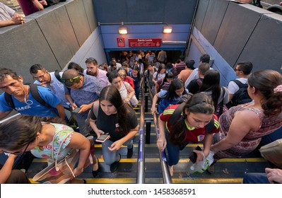 Santiago, Chile, July 2019: Rush hour crowded Santiago 's famous metro station