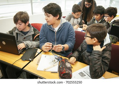 Santiago, Chile. July 21, 2017. Young unknown students in robotic laboratory.