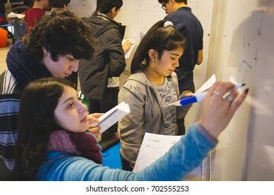 Santiago, Chile. July 21, 2017. Group of small unknown students in mathematics activities.