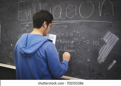 Santiago, Chile. July 21, 2017. Developing equation on blackboard.