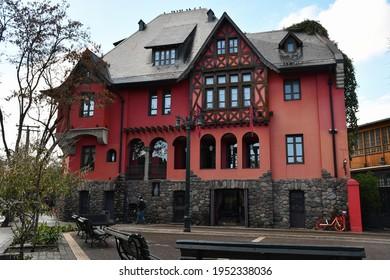 Santiago, Chile - June 15, 2019: Castillo Lehuedé, or Castillo Rojo (Red Castle), which now is a hotel, in Plaza Mori in the Bellavista neighborhood.