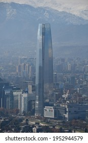 """Santiago, Chile - June 15, 2019: The Gran Torre Santiago skyscraper (Costanera Center Torre 2) and Costanera Center in the financial district nicknamed """"Sanhattan"""", against the backdrop of the Andes."""