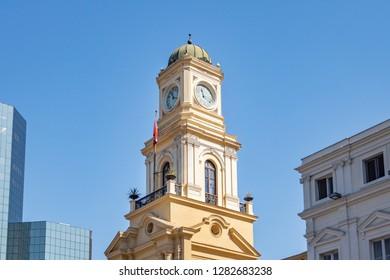 Santiago, Chile - Mar 6, 2018: National Museum of History Courtyard (Museo Historico Nacional) clock tower at Plaza de Armas Square - Santiago, Chile