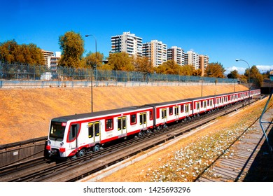 SANTIAGO, CHILE - MARCH 2017: During a sunny day, a Santiago Metro train goes to Pajaritos station