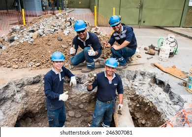 SANTIAGO, CHILE - NOV 1, 2014:  Unidentified Chilean constructor during their work. Chilean people are mainly of mixed Spanish and Amerindian descent