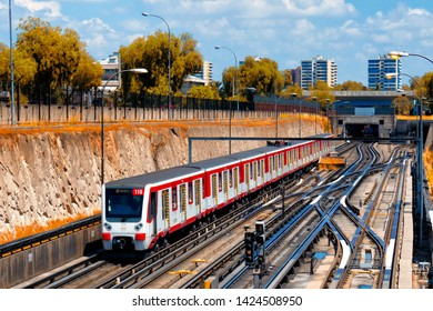 SANTIAGO, CHILE - NOVEMBER 2014: A Santiago Metro train in the middle of the city