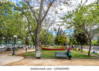 Santiago, Chile - Oct 14th 2017 - A local sitting in a public bench in a green open area in downtown Santiago, the capital of Chile in South America