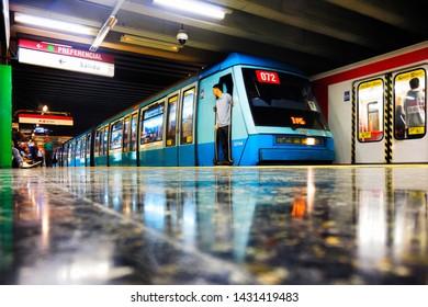 SANTIAGO, CHILE - OCTOBER 2015: Santiago Metro train stopped at Escuela Militar station, Line 1