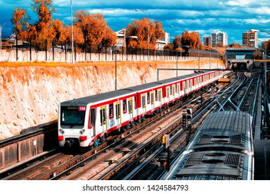SANTIAGO, CHILE - OCTOBER 2015: Two trains of the Santiago Metro with the clouds as a background