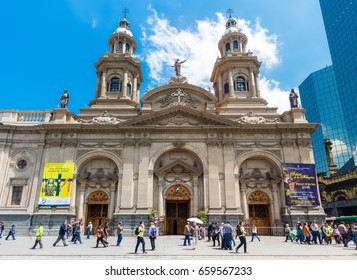 SANTIAGO, CHILE - OCTOBER 23, 2016: People on Plaza de Armas in front of Santiago Metropolitan Cathedral. This is the main sguare of the city, surrounded by historic buildings.