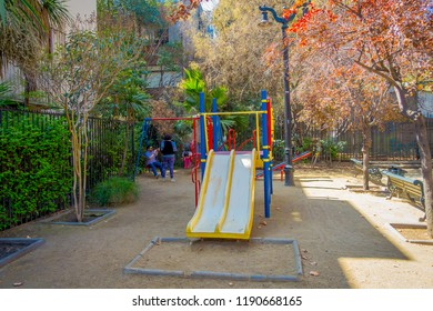 SANTIAGO, CHILE - SEPTEMBER 13, 2018: Unidentified family in a playground backyard of a house building in Lastarria neighborhood located in Santiago of Chile