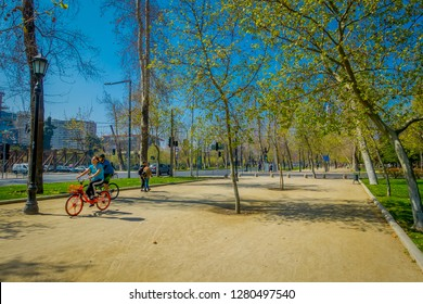 SANTIAGO, CHILE - SEPTEMBER 13, 2018: Unidentified blurred tourists relaxing in the Forestal park located in Santiago, capital of Chile