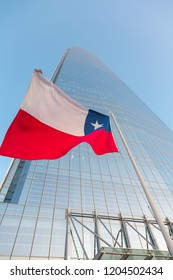 SANTIAGO, CHILE - SEPTEMBER 15, 2018: Bottom view of the Chilean national flag in the background of skyscraper Gran Torre Santiago