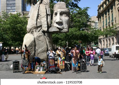 SANTIAGO, CHILE-NOV.2:  Mapuche Indians, an ethnic minority in Chile comprising less than 4% of the population, perform native music at Plaza de Armas on November 2, 2012 in Santiago, Chile.