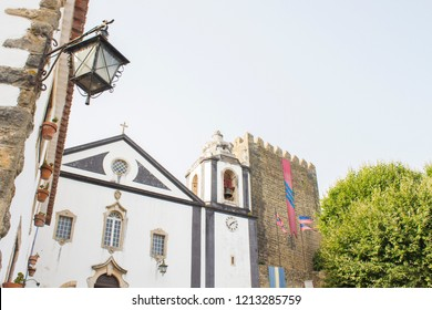 santiago church and medieval castle of obidos, portugal