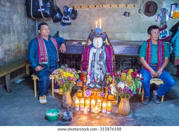 SANTIAGO DE ATITLAN , GUATEMALA - JULY 28 : Shrine of El Maximon in Santiago De Atitlan , Guatemala on July 28 2015 , Maximon saint/devil is one of the strongest remnants of the Mayan faith