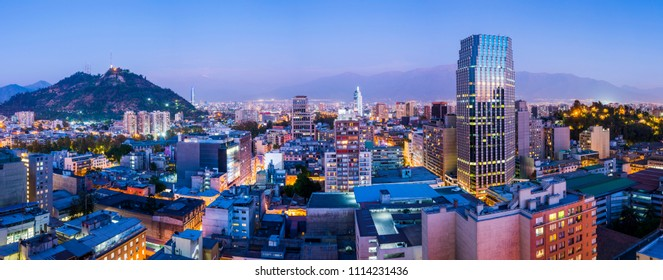 Santiago de Chile dwontown after sunset in a wide panoramic composition, Chile