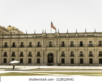 SANTIAGO DE CHILE, CHILE - JANUARY 26, 2018: View of presidential palace, known as La Moneda, in Santiago, Chile. This palace was bombed in the coup of 1973. Image with vintage and yesteryear effect