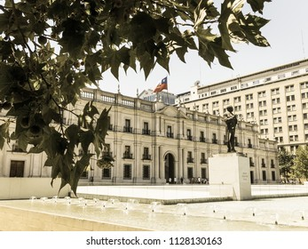 SANTIAGO DE CHILE, CHILE - JANUARY 26, 2018: Monument to Arturo Alessandri Palma in Santiago de Chile, in front of the Moneda Palace. Image with vintage and yesteryear effect