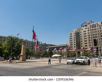 SANTIAGO DE CHILE, CHILE - JANUARY 26, 2018: Chilean flags waving in the Plaza de la Constitución, in the center of the city of Santiago de Chile, Chile.