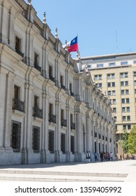 SANTIAGO DE CHILE, CHILE - JANUARY 26, 2018: View of the presidential palace, known as La Moneda, in Santiago, Chile. This palace was bombed in the coup of 1973