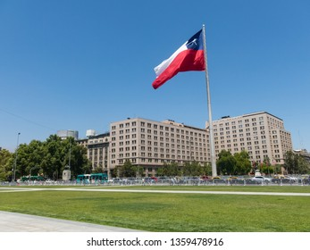 SANTIAGO DE CHILE, CHILE - JANUARY 26, 2018: Chileans walking near the giant flag on Avenida La Alameda with the citizenship Square, in downtown Santiago de Chile. Chile.