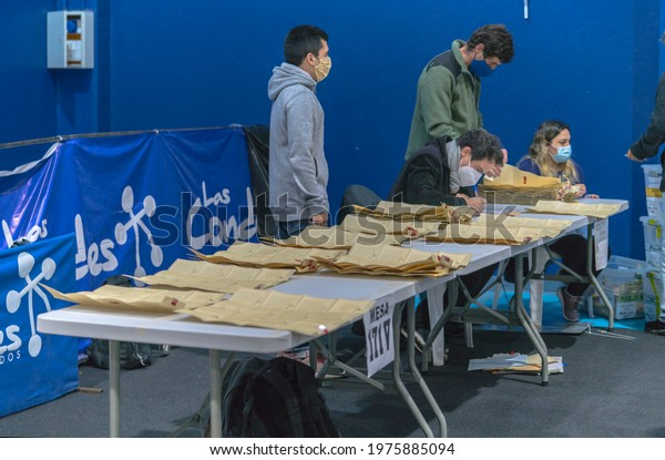 Santiago de Chile, Chile, May 16, 2021. Beginning of the process of counting and classifying many votes with a large number of candidates for constituents of the country's new constitution.
