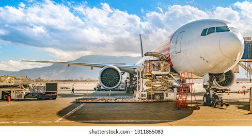 SANTIAGO DE CHILE, CHILE, MAY - 2018 - Commercial airline aircraft parked for supply and maintenance at Santiago de Chile airport, Chile