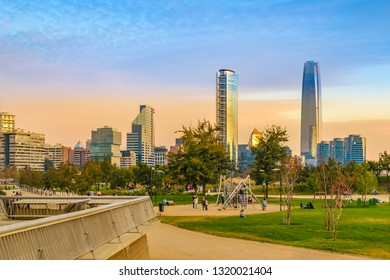 SANTIAGO DE CHILE, CHILE, MAY - 2018 - Bicentennial park and moderrn financial district at background in santiago de chile city.