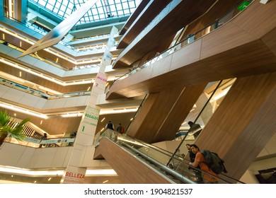 Santiago de Chile, Region Metropolitana, Chile - People at the escalator of Costanera Center Shopping Mall, the biggest in Latin America.